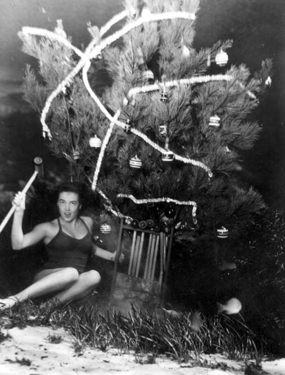 Mary Dwight displays croquet set gift she has just found under the underwater Christmas tree at Weeki Wachee Springs State Park, 1948
