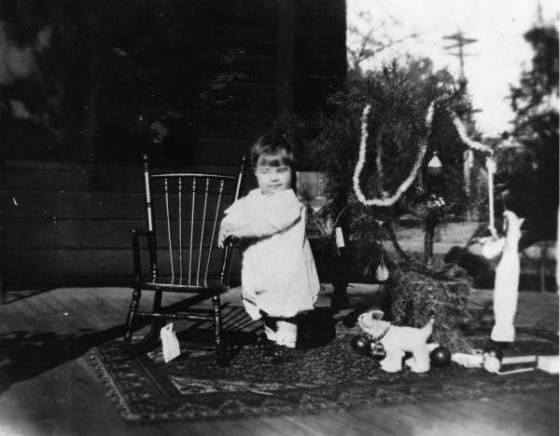 Child with Christmas tree and toys, 1912